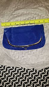 Royal blue velvet clutch with snap closure and peekaboo chain handle.