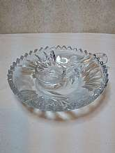 "This the under plate for serving bowl with matching glass  ladle. The plate has some chips on saw tooth and use scratches on bottom. Ladle has a chip also. Very pretty even though it has in perfection's.  Under plate bowl is 6"" across and the ladle"