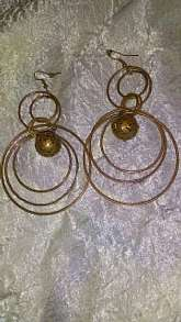 Large gold fashion dangle earrings