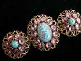 A most stunning Austro Hungarian Brooch with earrings..Beautiful cannetille  gilt wire work .. Faux turquoise cabochons with a matrix in unusual colors.. The cabochons are surrounded by pale amethyst paste rhinestones.. The wire work is back and front des