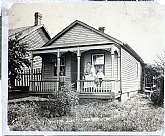 This is a set of three antiquarian photographs presumably taken in the St. Joseph, MO area in the 1880s.  Two of the photographs have the date 1882 handwritten on the back.  The largest of the three is of a family on the porch of their home, probably take