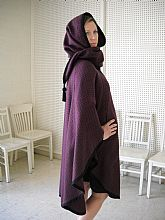 French cape with smaller capelet/scarf that flips up to form a hood.