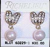 "These elegant, mint condition, vintage earrings were designed by Richelieu.  They are pierced and 5/8"" wide x 1 1/4"" in length.  Featured at the top are two gold toned leaves with pave crystals.  Below dangles a simulated round pearl.  Bought bu"