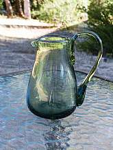 Vintage Blueish Green Hand Blown Bubble Glass Creamer Pitcher *Made during the 1960's to 1970's *A gorgeous blueish green hand blown bubble glass creamer dish that has a uniqueness only found in a hand made item such as this. *The overall condition is