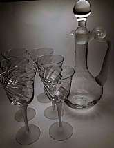 This listing is a Valerie Frosted Decanter & Wine Glass 7 Piece Set Made By Crystal Clear Industries. It is the complete so no searching for pieces to make it whole. Truly a gorgeous set that would look great in any dining room, office at work, bar