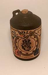 Vintage Japanese Stoneware Corked Sake Jug with a Paper Label*Made during the 1980's to 90's but im not sure of the exact time period.*It is excellent vintage condition with no damage and the original paper label is intact.*This is a great piece of ar