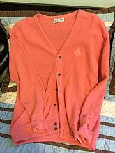 Mens Vintage Izod Crest Logo SweaterThis item is vintage and used, but in great overall condition.It is a cardigan style sweater and is completely peach with the Izod crest logo on the chest.100% Acrylic.Approx. measurement from armpit to armp