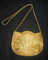 Gorgeous gold beaded purse from the late 50s. The purse is a little bit darker in color than the pictures depict. I'm not quite sure why the camera gave it such a