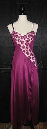 Vintage late 70's purple grape, nylon, full length nightgown is in excellent, very gently worn condition. There are no labels anywhere on this gown, but it is styled like Undercover Wear gowns of this era. The only flaw I could find was a tiny pull on the
