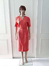 Classic Collection at Owen and Owen 1980's vintage coral knee length short sleeved dress.  The dress has small shoulder pads with an elasticated panel to the waist at back with small patterned goldtone button fastening to the front and two side pockets wi