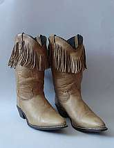 Sheplers 1980's vintage calf length pull on brown leather unisex cowboy boots with low western heels and fringe detail in a size 8 Material: Real Leather Made in the USAThere are some scuffs and marks to the leather, but otherwise in good vintage co