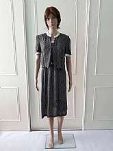 Hamells 1970's vintage mid length summer dress with matching short sleeved jacket.  The dress is black with white leaf detail with spaghetti straps.  There are two buttons to fasten at the back with an elasticated waist and an attached belt.  The jacket i