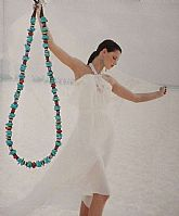 Genuine Semi-Precious Gemstones accent this Turquoise chip beaded Necklace, finished with Sterling Silver findings. Gemstones include: Amethyst, Coral, Jasper, and Opal- the Perfect combination- so Fresh & Versatile!