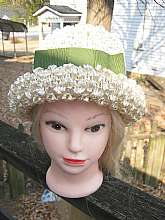 I love the nubby look to this vintage woven hat.  It is ivory colored and has a wide green ribbon and bow.  It also has a rolled brim.    There is some staining inside as shown in the photo. The inside circumference is 20 1/2 to 21 inches.  Please contact