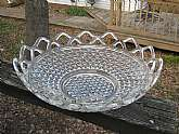 This is a wonderful centerpiece bowl with an open lace scalloped rim.  The outside has a triangle/ diamond design.  It is in very good used condition. There is a small chip on the bottom of the bowl on the inside. You have to look close to see it. There a