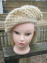 This is a nice vintage crocheted beret in a cream colored yarn.  It has an open lacy design.  The opening is five inches in diameter.  It is clean inside.  It's in good used condition with no loose strands of yarn.  If you have any questions, please conta