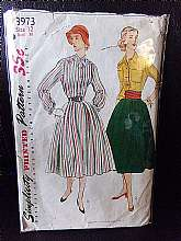 This is a vintage 1940s dress pattern from Simplicity.  It's pattern #3973 and is a size 12.  The pattern is a shirt dress pattern with long sleeves.  It is complete with no missing pieces.  The envelope is in good used condition
