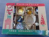 This vintage Christmas tree ornament box has eight ornaments.  They are assorted sizes and colors.  Good used condition with mild discolorations and missing paint.