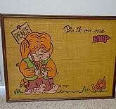 "This is a Burlap cork board made in 1970.  The Basset Hound dog is holding a ""PEACE"" sign and on the top of the board reads ""Pin it on me baby""  such a cool retro board and in great vintage condition.  The board is 24"" in length a"