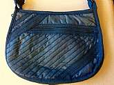 This listing is for a funky blue fabric fashionable shoulder bag from the 1970's.  This is a shoulder bag with a strap that is non-removable and not adjustable.  The bag has a slanted zipper pocket in the front, 3 large pockets on the inside along with a