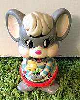 This listing is for an adorable plaster mouse coin bank.  This bank was made in the 1960's by Holiday Fair Co.  The painted colors chosen for this mouse are super vibrant and some even fluorescent.  The bank is in good, but used condition with minimal wea