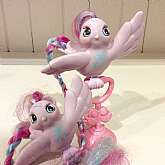 "This listing is for 2 My Little Pony "" Fairy Tail Tinsel Tails"" with perch!These adorable, long tailed birds were made by Hasbro in 1987 as part of the MLP G1 line. They are similar to MLP as you can also brush their long colorful tails.  The"