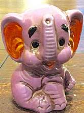 "This listing is for an adorable, purple baby elephant coin bank that was made in Japan.  It measures 3.5"" tall and does have original rubber coin stopper.  Great condition for its age.Thanks for looking!"