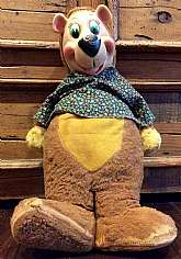 "This listing is for a 1958 plush Yogi Bear doll!  He is wearing a floral shirt and measures 19"".  He is fully plush other than his vinyl face (his nose has a little hole on one side....please see photos).  He is in fairly good condition for his age w"