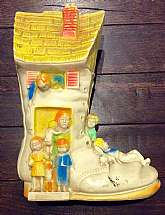 "This listing is for a 10"" tall vintage vinyl coin bank!This bank was made in the early 1970's and is a large white boot with an old woman and a bunch of children and pets.The colors include blue, yellow, orange and green and all are super vibrant"