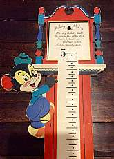 This listing is for an adorable Hickory Dickory Dock wall hanging growth chart!This Kitchy piece was made in 1949 by Dolly Toy Company and is made of very thick cardboard with a ribbon tying the two pieces together.  When closed it simply looks like a cu