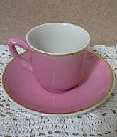 This is a beautiful Bubblegum Pink mini teacup and saucer made by Syracuse China Co. U.S.A.  The saucer is 4.5