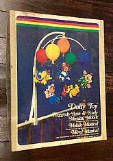 This listing is for an adorable Raggedy Ann musical mobile!This mobile was made by Dolly Toy Co. in 1980.  This is a musical mobile and in working condition!  Raggedy Ann and friends hang from multicolored, plastic balloons and when the the little knob o