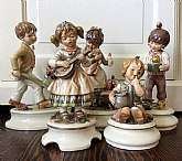 This listing is for 5, vintage Goebel Lore porcelain, hand painted figurines.  These figures were made by Lore in West Germany between 1970 & 1978.With your purchase you will receive the following figures:1970 boy pushing dog # 250 1972 girl playin