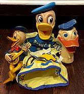 This listing is for 3 vintage Donald Duck toys!I don't know much about these toys other than they are Disney collectibles.  With your purchase you will receive the following:Donald hand puppetDonald head??Donald plastic figurine.Please feel free to c