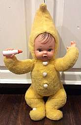 This listing is for a vintage, 1950s vinyl face, yellow plush babydoll!!I believe this is a Rushton doll, but there are no seam tags.  The doll is not necessarily rare, but finding one in this color and condition is extremely hard to find.The doll is a