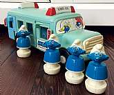 This listing is for a 1982 Peyo Smurfs school bus toy with 4 Smurfs!!  The base of the bus rotates when moved.  You simply put the smurfs in it and when the bus is pushed, they come out of the other door.  Super cute and I must say entertaining.  The bus