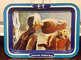 This listing is for an E.T. (Extra Terrestrial) metal folding tray!This tray was made by Universal Studios in 1982.This lap tray has folding legs and measures approximately 17