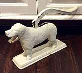 "This listing is for a 1940s cast iron Nutcracker dog!The dog measures approximately 11"" in length and when his lever is lifted his mouth opens for nut placement and when lever lowered, his mouth cracks the nut.The dog is fully white and in good, wo"