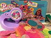 This listing is for a Poochie flower note maker with accessories in its original opened box!!This plastic Poochie flower/note maker was made in 1983 by Mattel.With your purchase you will receive all you see in the photos which includes the following:-