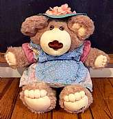 This listing is for Hattie Furskin!  She is part of the Coleco Furskins family designed by Xavier Roberts.  These adorable Furskins Bears are cousins to the Cabbage Patch Kids.  Hattie is wearing her original outfit (including her floral hat, but no shoe