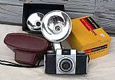 Vintage Kodak Pony II 35mm camera with a leather case made in from 1957 - 1962. The camera is in very good condition but has not been tested.  The case shows wear but is intact.  It also comes with 2 flash attachments and the field case box.  This item is