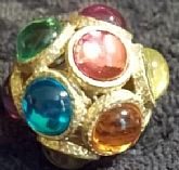 Gold tone ball with colored glass cabochons