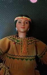 This is a doll that was part of an Avon collectible line. Perfect condition.