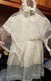 This is a really unique find.  I am assuming it is a first communion little girl's dress with veil.  It is hand made and no rips tears or stains.  It is missing the sash that goes at the waist.  I have not washed it so it will come in unwashed condition.