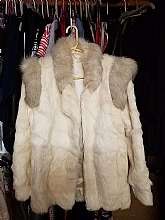 This is a gorgeous vintage rabbit fur coat.  It is lined and zips up and has pockets.  I wear a size Large and it fits me well.  The coat is 31 inches long and 17 across from should to shoulder and the arms are 25 inches long with snug fitting cuffs to ke