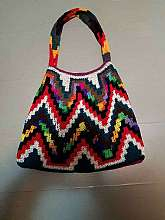 This is so beautiful and has gorgous vivid colors.  It is handmade and vintage and very stylist.  It is in perfect shape.  18 inches at its widest and 25 inches from top of strap to bottom of bag.
