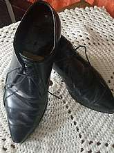 "A very nice pair of Raleigh Square brand of men's black dress shoes.  They show normal ware but are in very good condition.  There is no visible size.  They are 11"" from toe to heel. 4"" at the widest part.  I wear a lady's size 8 and these would"