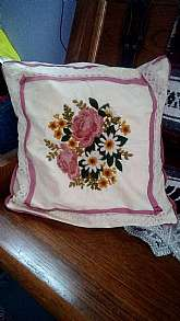This is a sweet vintage floral handmade needlepoint pillow and cover.  It is 16 X 16 and can be removed from the pillow form (fiberfill encased pillow form) for easy washing.  Keep in mind it is handmade so not perfect but surely one of a kind.  It is in