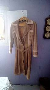 This is a beautiful suede lined long coat in great shape  It is 43 inches long.  It is belted and has no stains rips or tears.  The size is not on it but I will say and 8 or Medium in Women's.  It is a great addition to any closet...a staple piece.