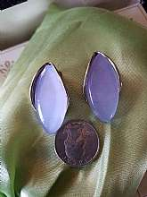 Very pretty and quite large clip on earrings in perfect shape.  The stone is interesting and a light blue but almost periwinkle as well.